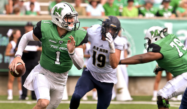 All dressed up and nowhere to go, Marshall University QB Chase Litton scrambles and looks for a receiver with Akron's Daumantis Venckus in hot pursuit during the second half action Saturday afternoon that saw Marshall go down to defeat 65-38 at Joan C. Edwards Stadium in Huntington. Bob Wojcieszak/Parthenon
