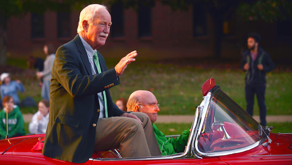 Red Dawson waves as he is cheered in this year's homecoming parade. Dawson was Grand Marshall of the parade.