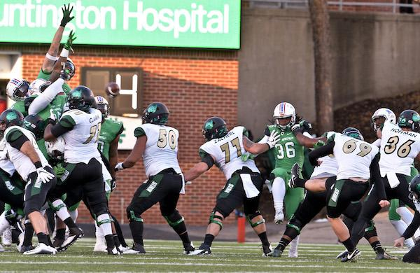 The Thundering Herd defense manages to block a first half Charlotte 49ers field goal attempt during Thundering Herd football action Saturday afternoon at Joan C. Edwards Stadium in Huntington. Bob Wojcieszak/Parthenon