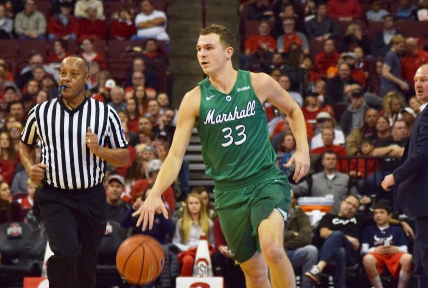Marshall+junior+guard+Jon+Elmore+brings+the+ball+up+the+court+against+Ohio+State+Friday+night.+Elmore+recorded+25+points+in+the+Herd%27s+111-70+loss+to+the+Buckeyes.