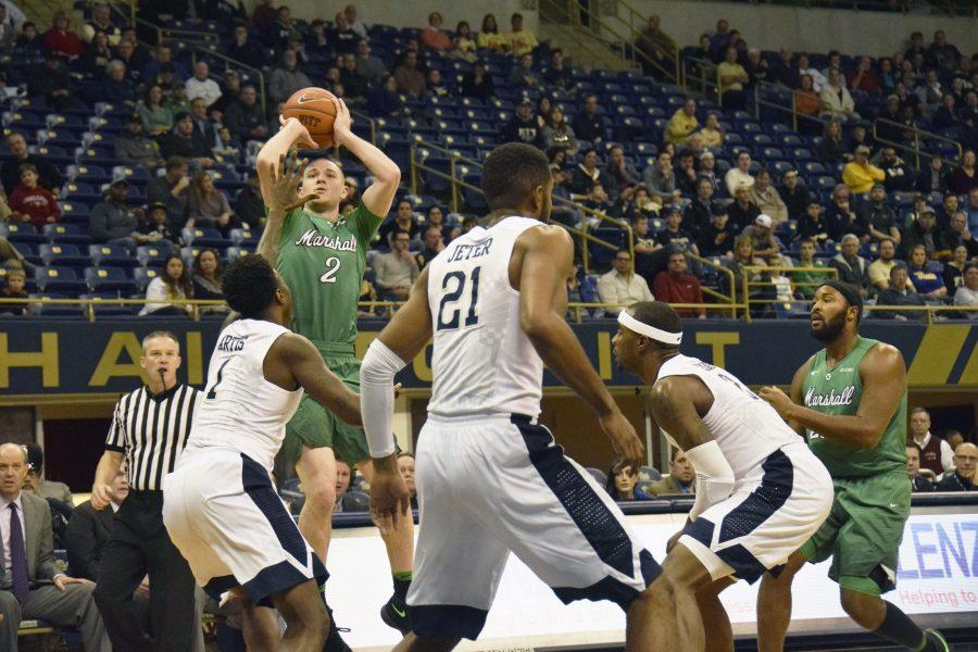 Marshall guard Stevie Browning (2) pulls up for a shot attempt over Pittsburgh guard Jamel Artis (1) in Wednesday's 112-106 loss to the Panthers.