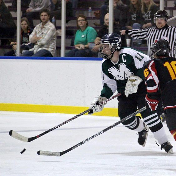 Marshall hockey captain Steven Macuch (11) brings the puck up the ice in an away game against the Wheeling Jesuit Redbirds.