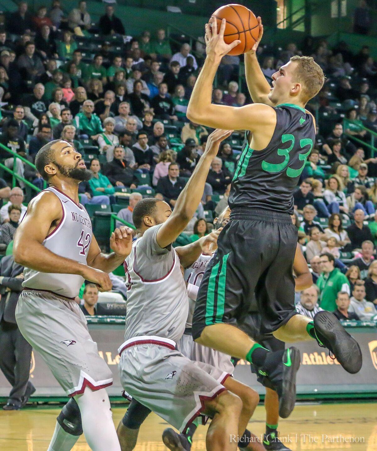 Marshall guard Jon Elmore (33) drives to the basket against North Carolina Central on November 12. Elmore is one of nine players from the state of West Virginia on the team.