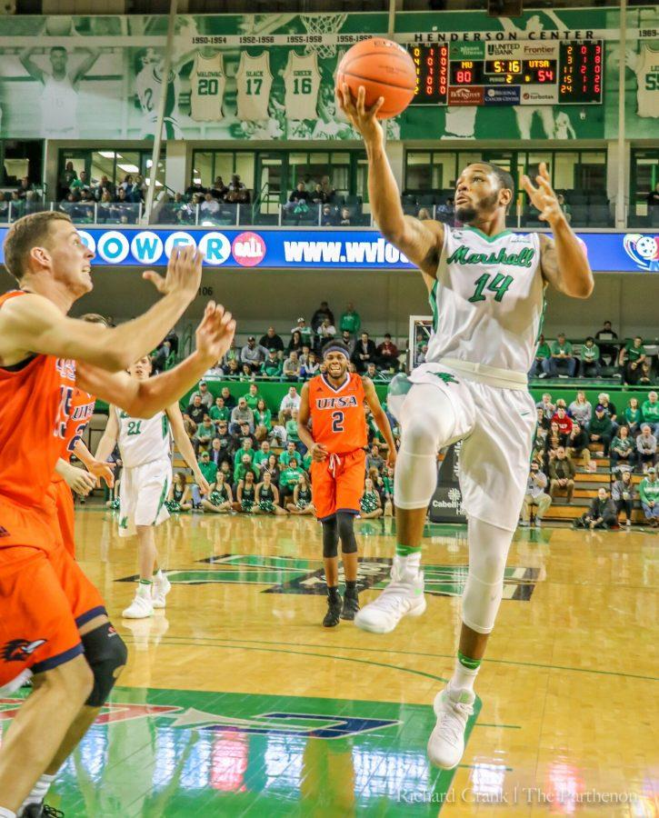 Marshall+guard+CJ+Burks+%2814%29+attempts+a+runner+against+UTSA+Thursday+night.+Marshall+won+92-71+to+stay+undefeated+at+the+Cam+Henderson+Center.