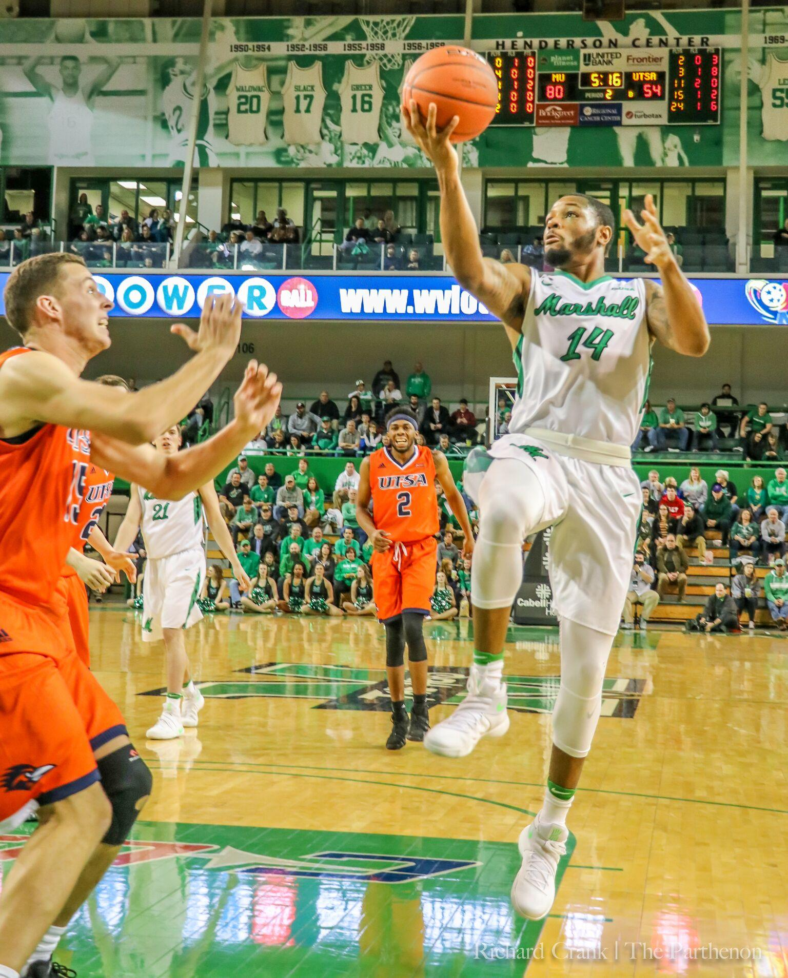 Marshall guard CJ Burks (14) attempts a runner against UTSA Thursday night. Marshall won 92-71 to stay undefeated at the Cam Henderson Center.