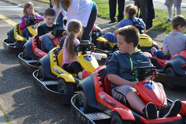 Children test out new cars at Safety Town while learning the rules of traffic safety.