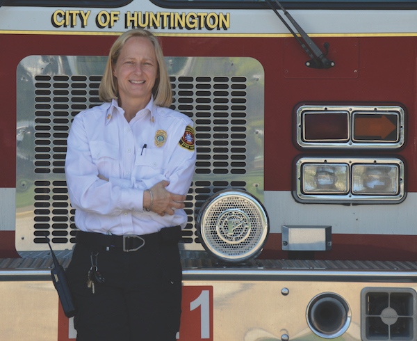 Rader stands in front of a Huntington fire engine.