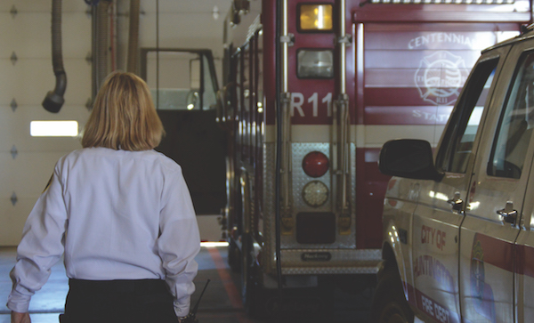 Jan Rader walks towards a fire engine. Rader has worked since 1994 serving the public in a variety of ways.