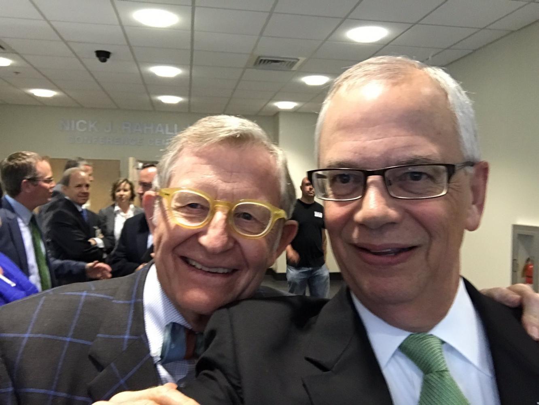 West Virginia University President E. Gordon Gee (left) and Marshall University President Jerome Gilbert take a selfie at (Twitter Image)