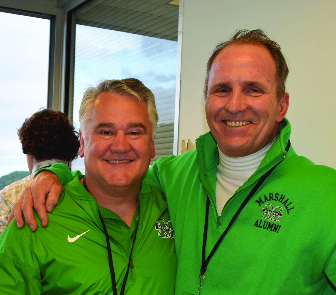 Brian Swisher (left) and Don Johnson pose for a photo during Marshall football's season opening win against the Miami (Ohio) RedHawks at  Joan C. Edwards Stadium Saturday, Sept. 2.
