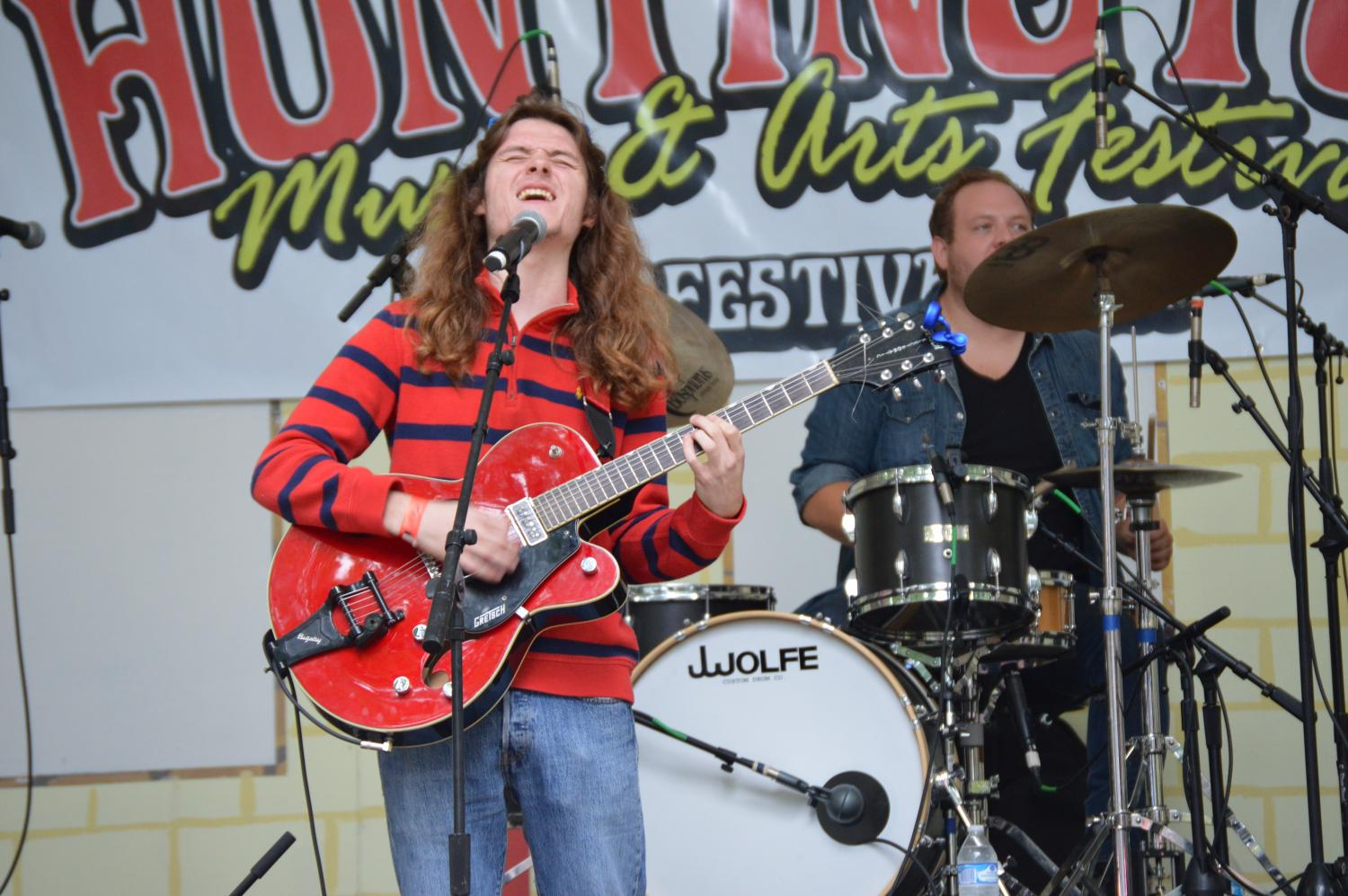 Corey Hatton of the band Of the Dell preformed for the second time at the Huntington Music and Arts Festival Saturday.