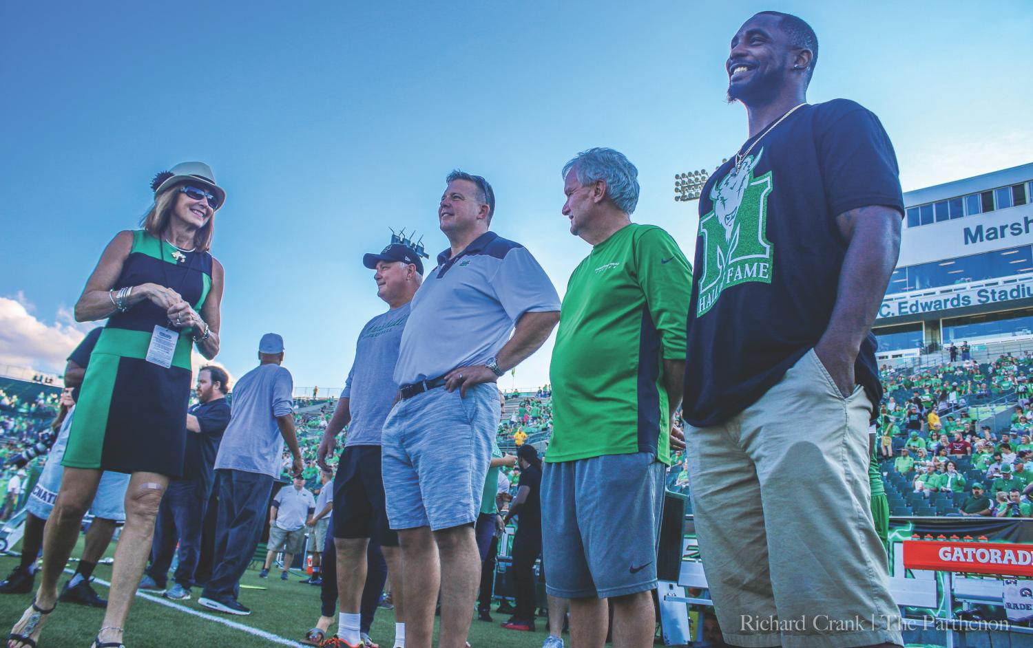 Members of Marshall Athletics' 2017 Hall of Fame class wait to be recognized prior to kickoff of the Thundering Herd's second home game of the year against Kent State. This year's class included Ahmad Bradshaw, Bob Gray, Eric Ihnat, Bill James, Katie Stein Mason,  Amanda Williams Paz, Keith Veney, David Wade and Rusty Wamsley.