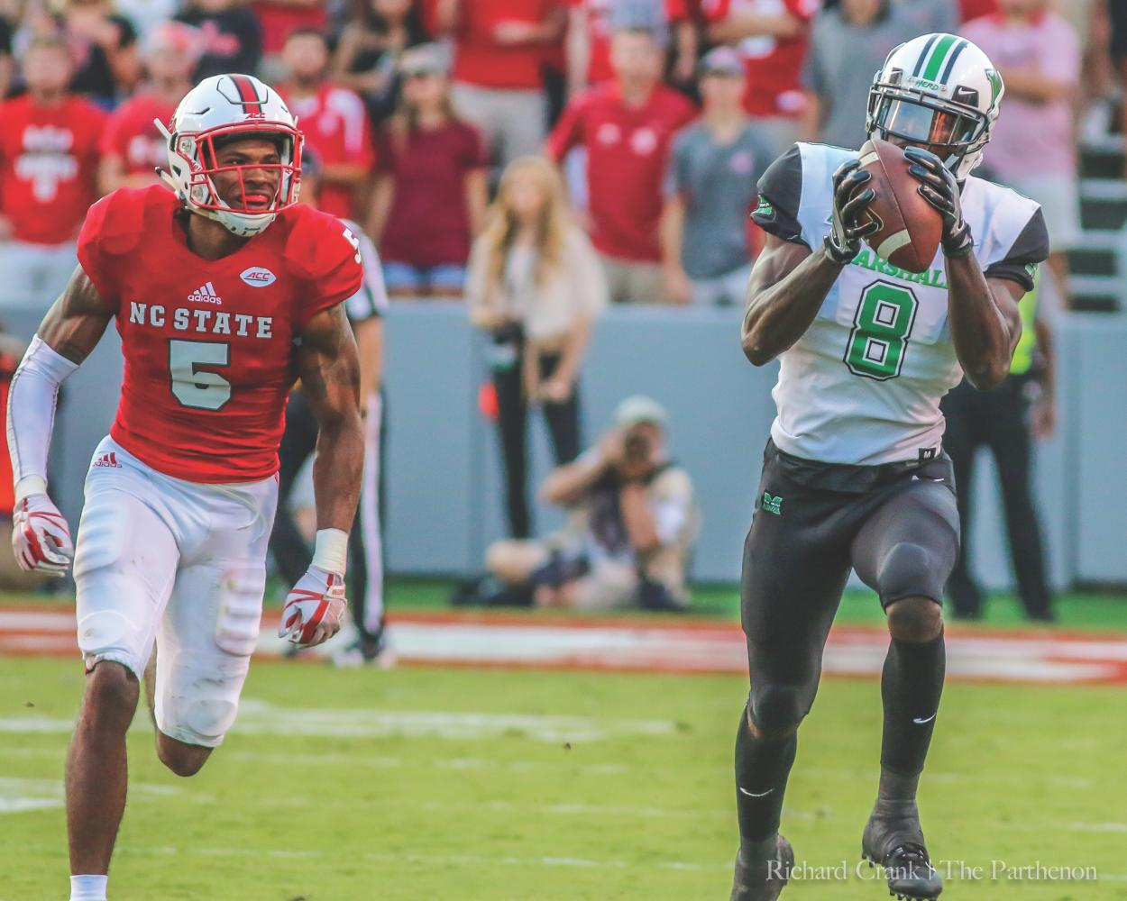 Marshall redshirt junior wide receiver Tyre Brady (right) breaks away from NC State cornerback Johnathan Alston during the Thundering Herd's 37-20 loss to the Wolfpack in Raleigh, N.C. at Carter-Finley Stadium.