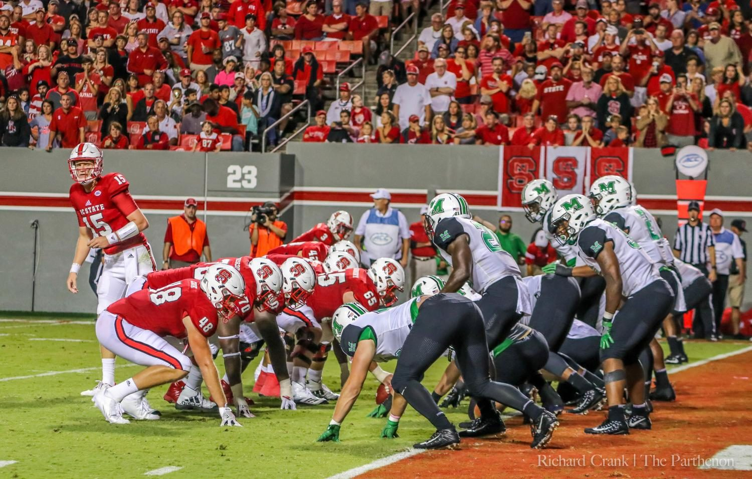 NC+State+redshirt+junior+quarterback+Ryan+Finley+looks+over+to+the+Wolfpack+sideline+for+the+play+in+a+goal+line+situation+against+Marshall+at+Carter-Finley+Stadium+in+Raleigh%2C+N.C.+Saturday%2C+Sept.+9.+The+Thundering+Herd+led+20-10+with+5%3A07+remaining+in+the+first+half%2C+but+allowed+the+Wolfpack+to+score+27-unanswered+points+and+lost+37-20.