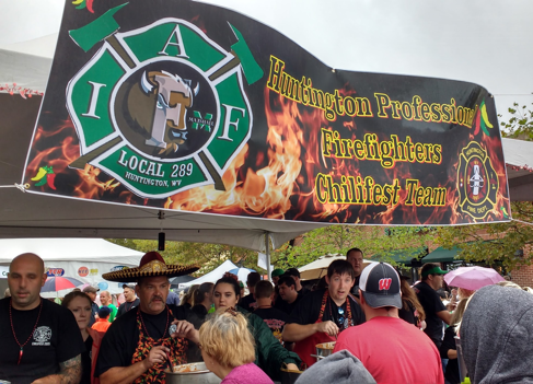 Huntington Professional Firefighters serve their team's chili at the 2015 ChiliFest.