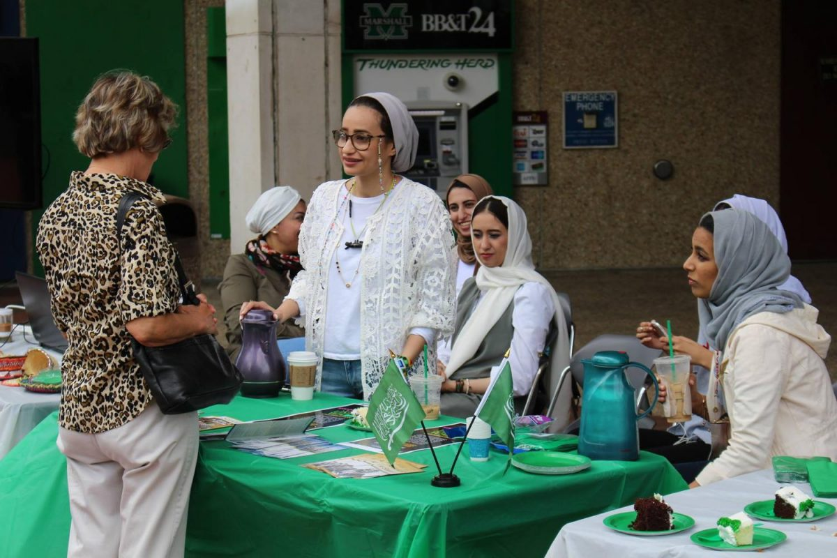 The Saudi Arabia Students Association celebrates Saudi Arabia National Day on the Memorial Student Center plaza Thursday, bringing cake, arabic coffee and cultural discussion to Marshall's campus. Saudi Arabia National Day celebrates the founding of Saudi Arabia in 1932. This was the fifth year the Marshall organization has held the celebration.