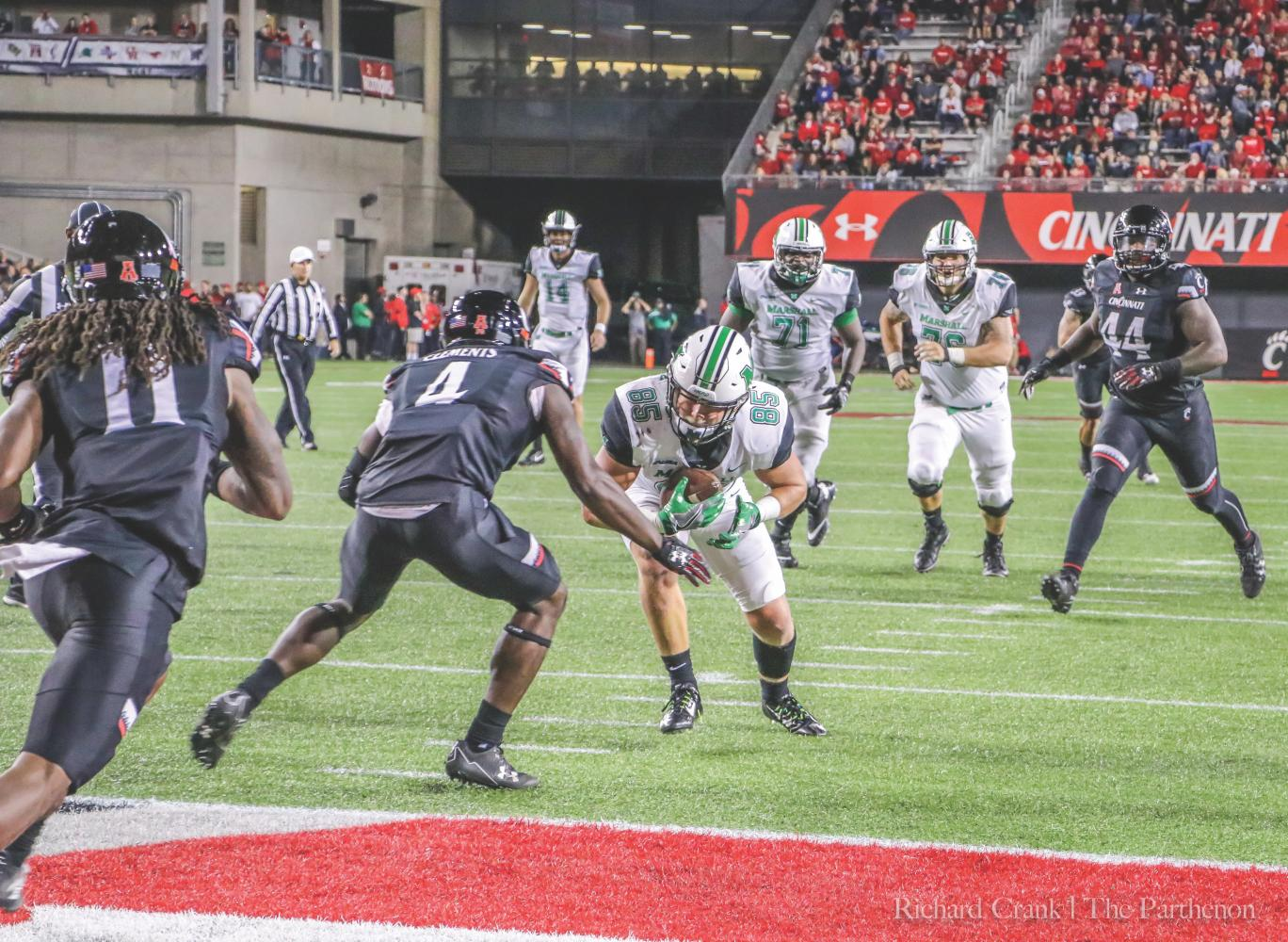 Senior tight end Ryan Yurachek (85) lowers his shoulder on his way to score a touchdown against the Cincinnati Bearcats in Nippert Stadium Saturday. Yurachek finished with three touchdowns on six receptions and 77 yards.