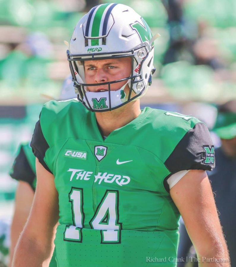 Marshall+junior+quarterback+Chase+Litton+warming+up+prior+to+kickoff+of+the+Thundering+Herd%E2%80%99s+homecoming+game+35-3+win+against+the+Old+Dominion+Monarchs+Saturday+at+Joan+C.+Edwards+Stadium.+Litton+is+now+eighth+in+Marshall+history+for+career+passing+yards+with+6%2C599+after+he+threw+for+176+yards+in+the+win+over+ODU.