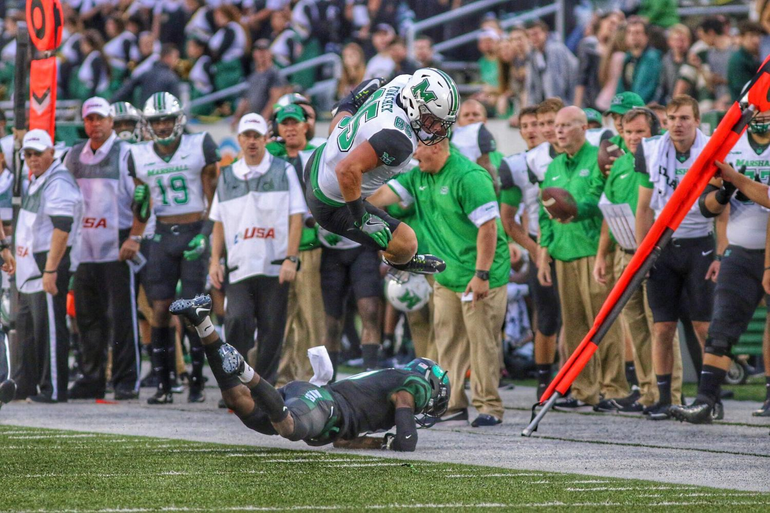 Ryan Yurachek leaps in the air after catching one of his three first half receptions. He now has a 34-game reception streak.