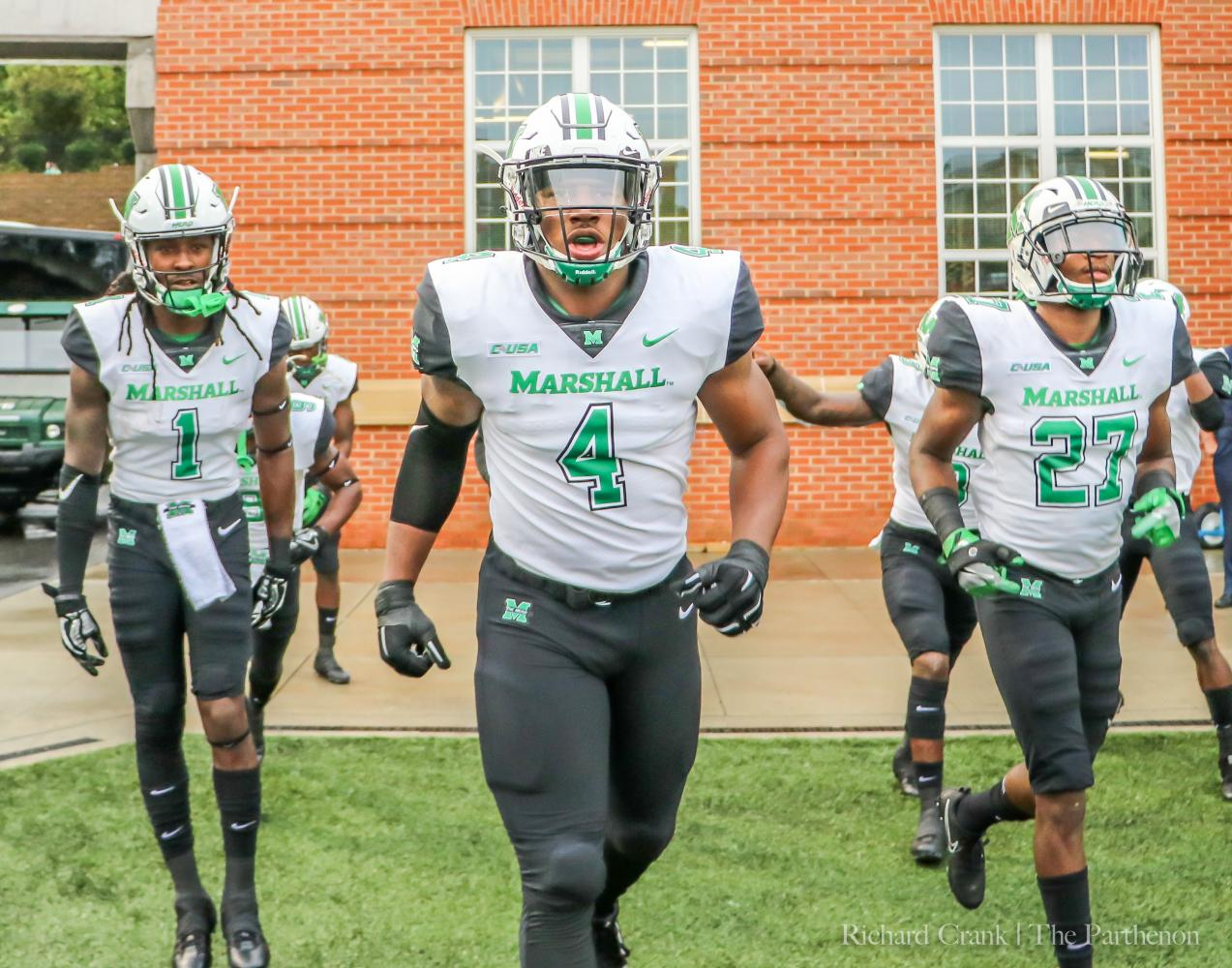 Junior linebacker Juwon Young enters the field at Jerry Richardson Stadium in Charlotte, North Carolina for his first game in a Thundering Herd uniform after serving a suspension for the first four games of the year.