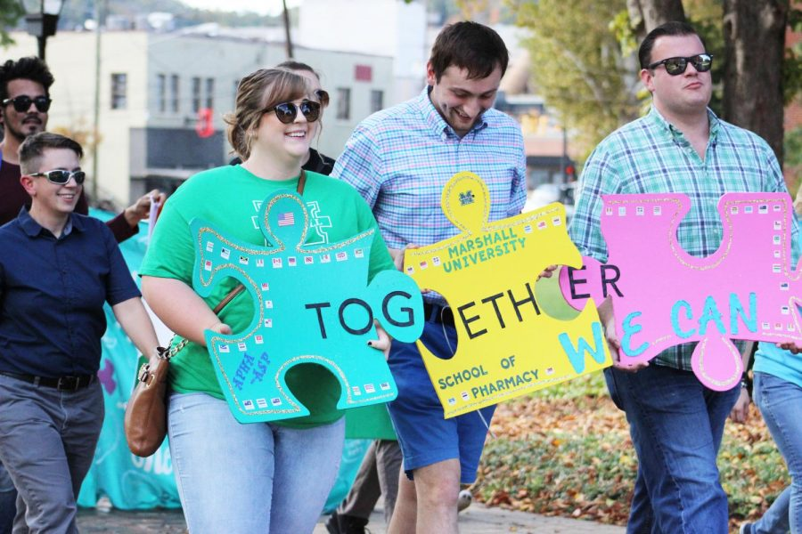 Marshall students participate in the 6th annual Unity Walk Monday, an event that aims to spur togetherness among Marshall students and the local community. The walk is the first of several homecoming events planned this week.