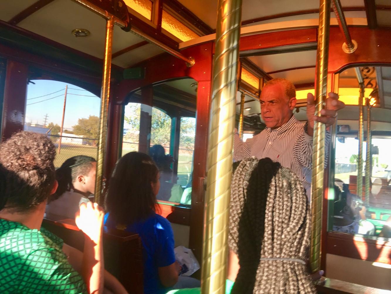Vice president of Intercultural Affairs Maurice Cooley leads the 45 minute tour about the history of Huntington and trolley.