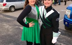 Marshall University band a family tradition for two sisters