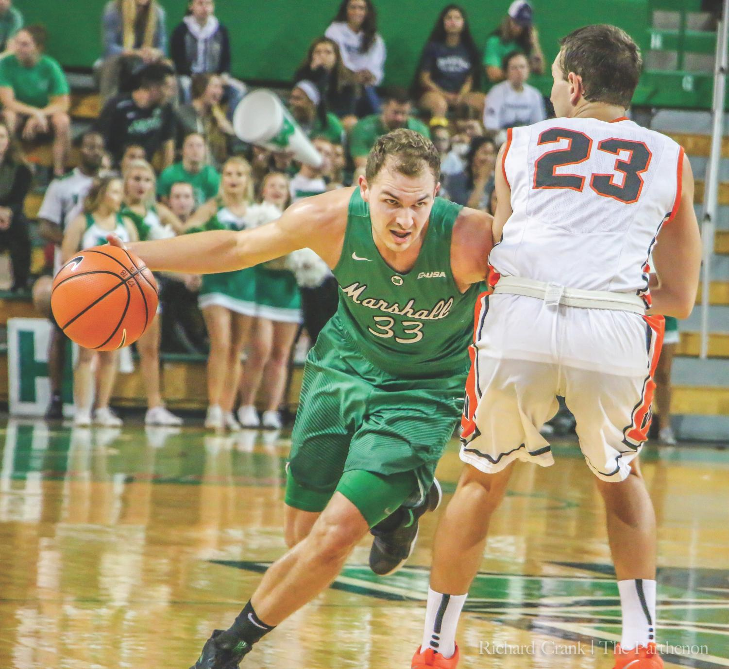 Marshall men's basketball guard Jon Elmore drives past his defender from West Virginia Wesleyan in the Thundering Herd's 95-76 exhibition win on Sunday in the Cam Henderson Center.