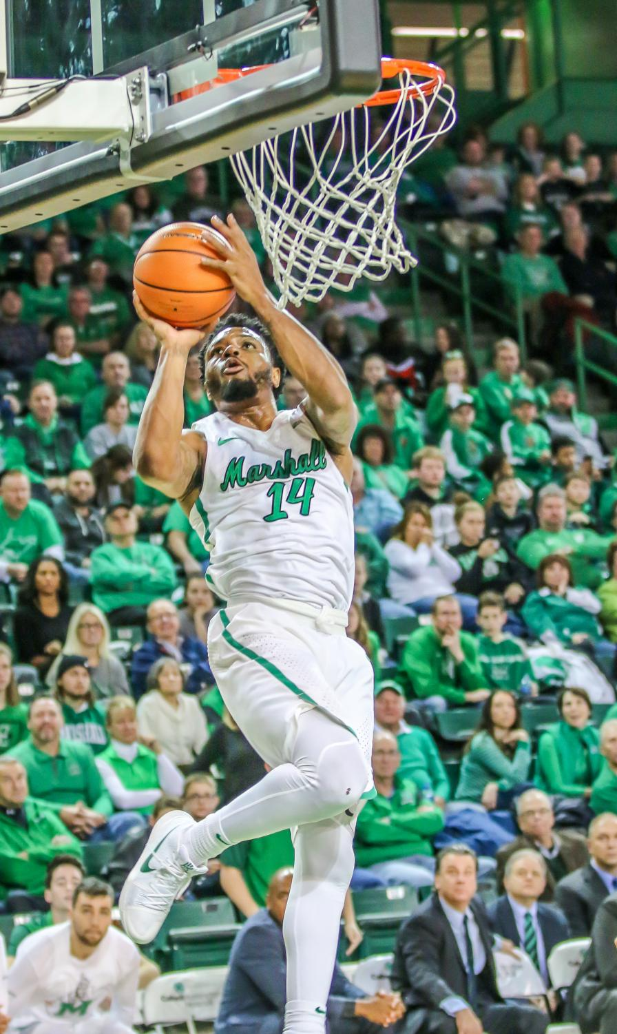C.J. Burks drives for a layup against WKU. Burks had a game-high 24 points in Marshall's last contest against ODU.