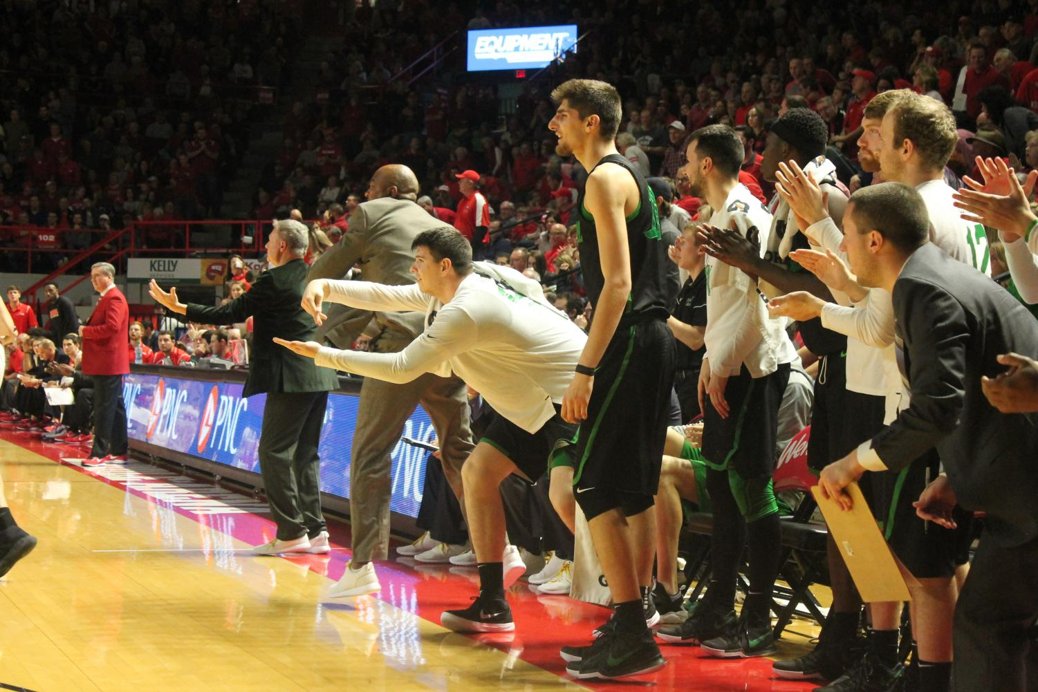 Marshall%27s+bench+celebrates+a+three+point+shot+to+take+the+lead+late+in+the+game.+Senior+forward+Milan+Mijovic+makes+a+celebratory+gesture.