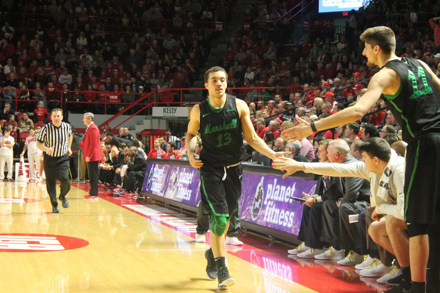 Freshman+guard+Jarrod+West+high+fives+his+teammates+after+hitting+a+three-pointer.+West+is+an+important+part+of+Marshall%27s+future.