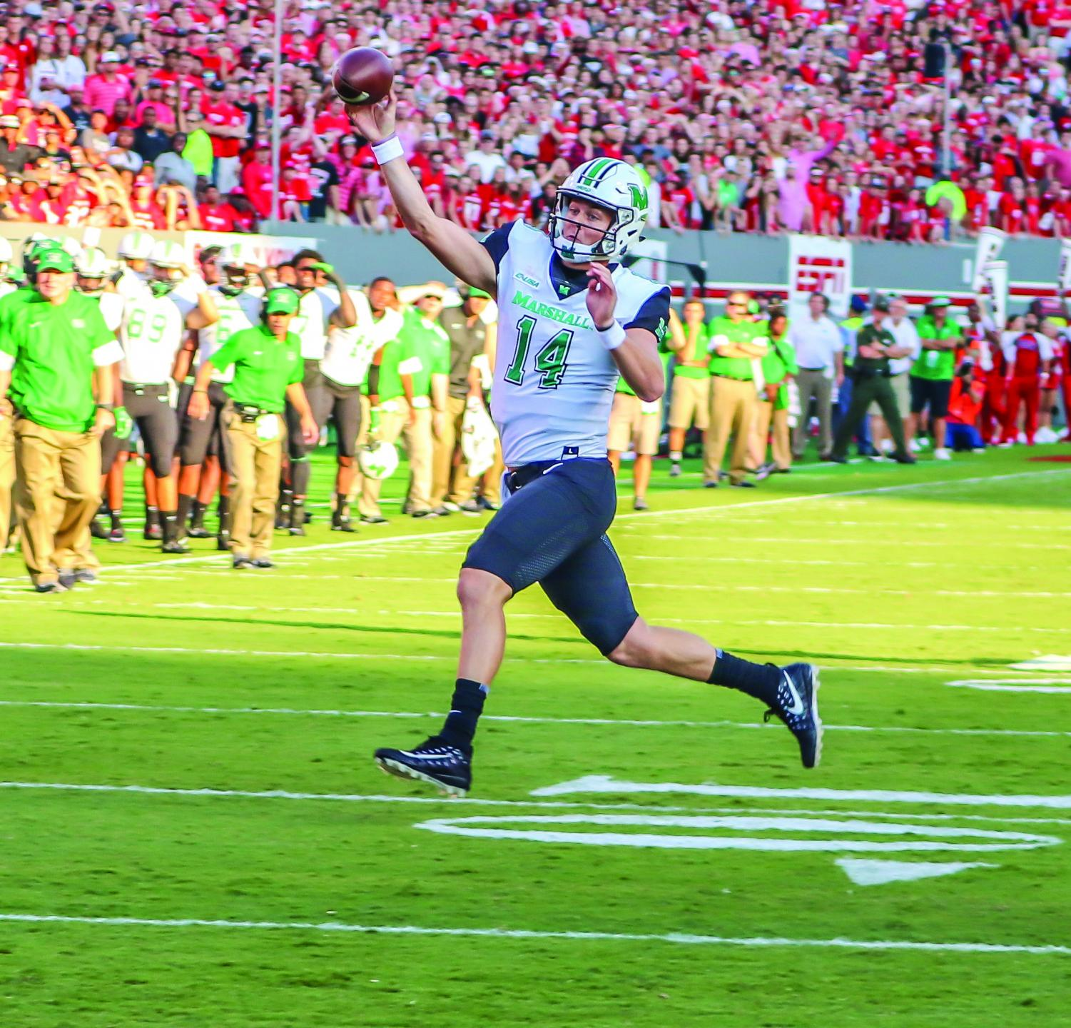 Chase Litton rolls out to pass in Marshall's 2017 contest at N.C. State. He threw for 350 yards and two touchdowns in a 37-20 loss to the Wolfpack.