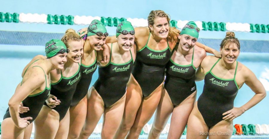 Marshall+seniors+pose+poolside+after+their+final+home+meet.+Pictured+%28L-R%29%3A+Emma+Lockyer%2C+Madi+Pulfer%2C+Savannah+Ruedt%2C+Anna+Lynch%2C+Rachel+DePietro%2C+Lauren+Cowher%2C+Shir+Wasserman.