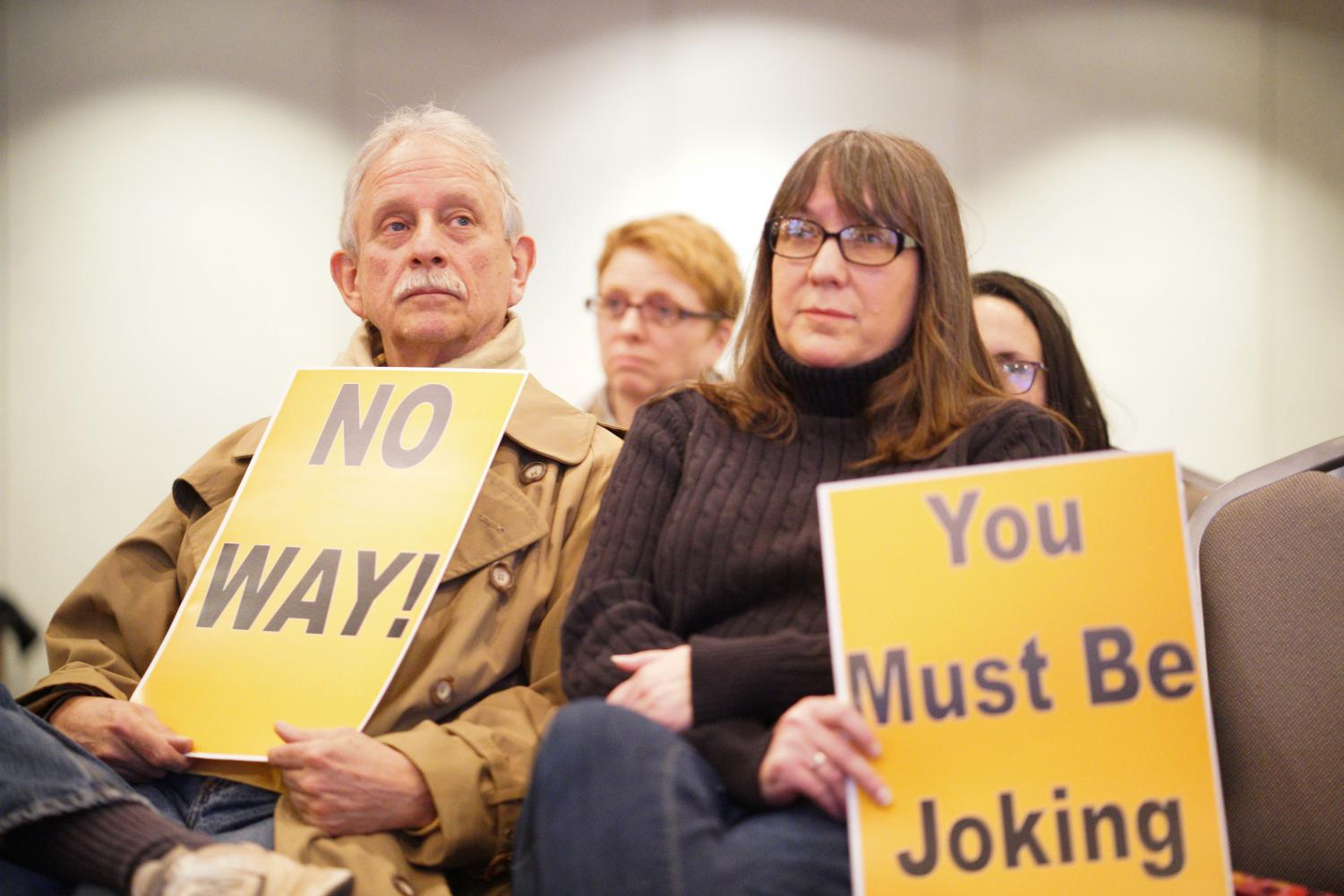 Protesters in the crowd during Blankenship's town hall meeting.