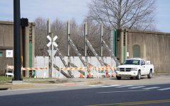Huntington prepares for flooding by raising flood gates