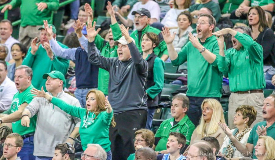 Herd fans express discontent with a referee's call on the court. This happens frequently at home games.