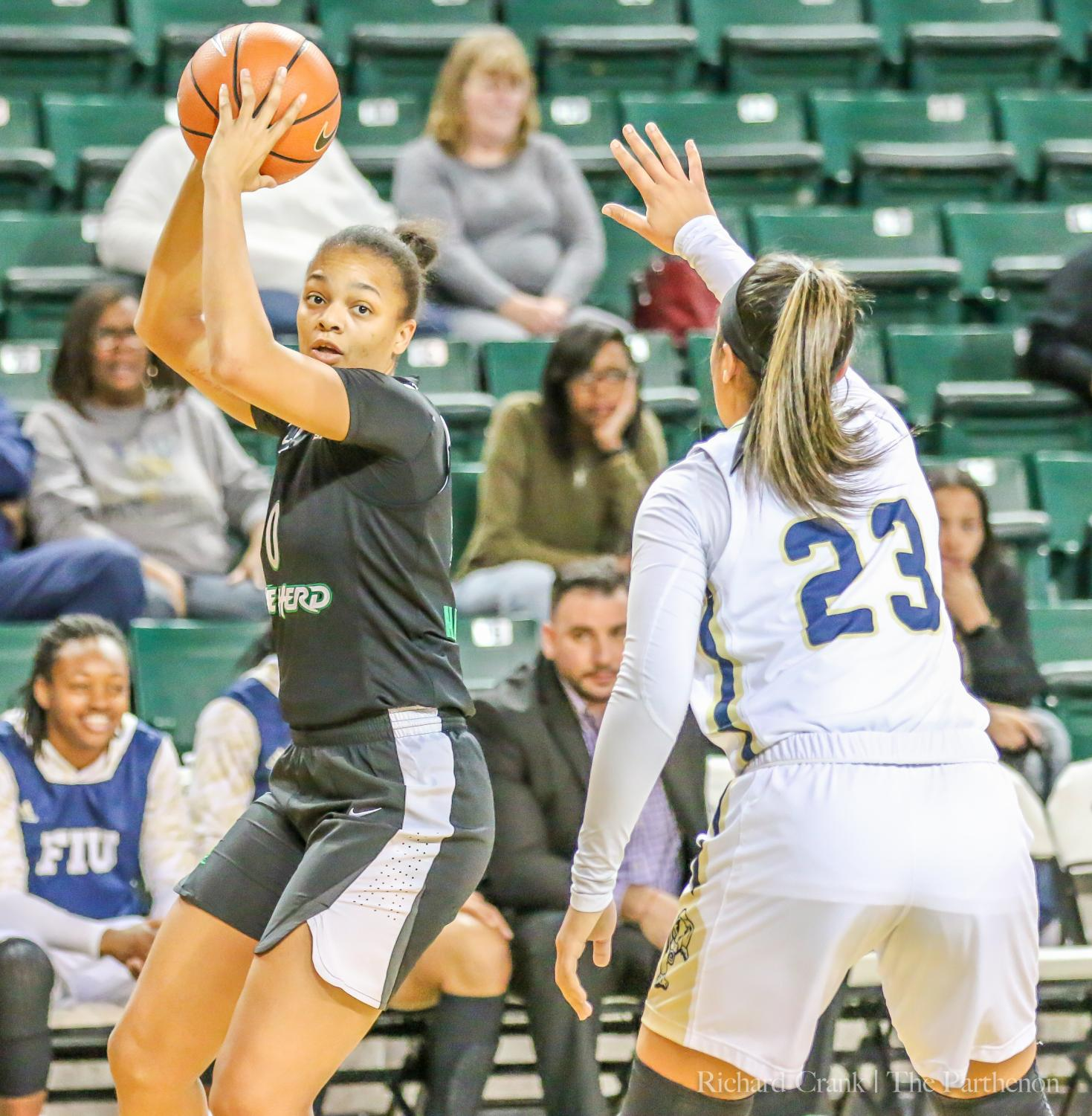 Talequia Hamilton fends off an opposing player during the Herd's home games against FIU Jan. 28.