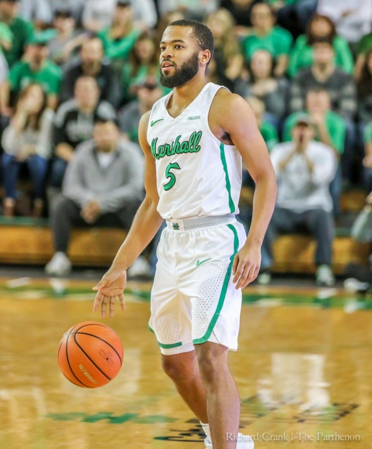 Senior+guard+Marcus+Reed+dribbles+out+the+ball+as+the+clock+winds+down+in+Marshall%27s+defeat+of+Charlotte.+Reed+plays+the+final+minutes+of+his+Marshall+career.