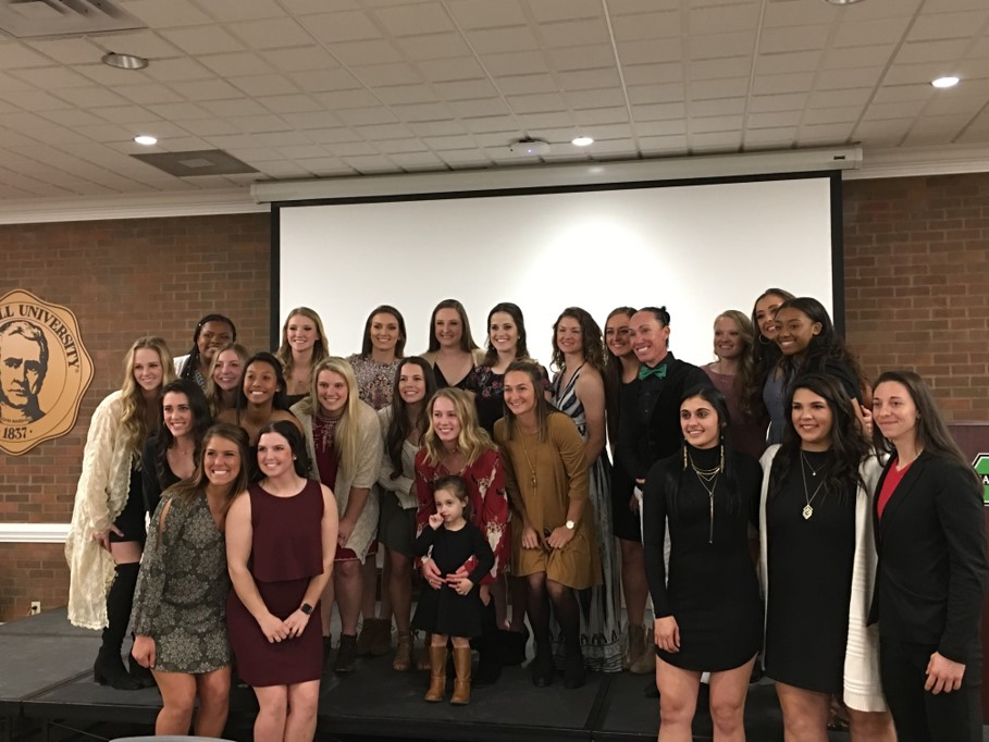 Marshall's 2018 softball team poses for a photo with three-time National Pro Fastpitch Most Valuable Player Kelly Kretschman at the Herd's annual Diamond Club banquet.