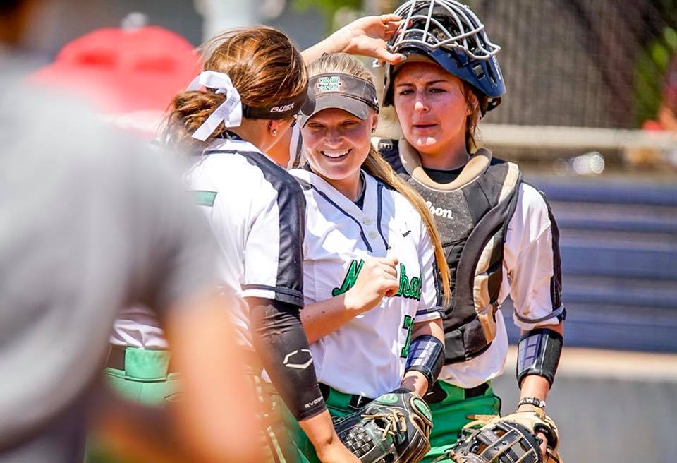 Senior catcher Taylor McCord, sophomore pitcher Kailee Williamson and sophomore infielder  Blakely Burch greet one another during pre-game introductions. Williamson would pitch 5 1/3 innings in Marshall's game three rubber match, while Birch and McCord would combine for seven total hits throughout the three-game series.