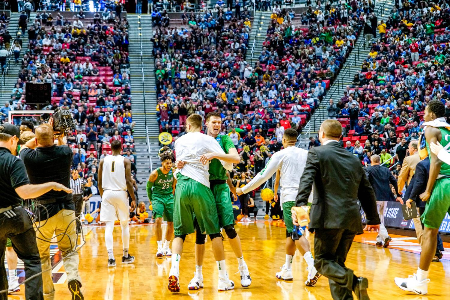 Junior+forward+Ajdin+Penava+and+redshirt+freshman+guard+Jannson+Williams+hug+in+celebration+as+the+game+clock+winds+down+for+a+Marshall+win.+