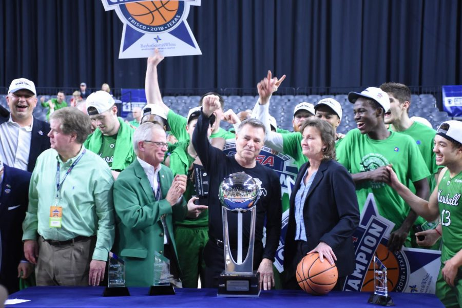 (L-R) Marshall president Jerome Gilbert, head coach D'Antoni and C-USA commissioner Judy MacLeod stand around the C-USA Championship trophy during the post-game celebration.
