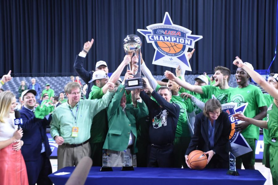 Marshall+Universty+athletic+director+Mike+Hamrick%2C+president+Jerry+Gilbert%2C+head+coach+Dan+D%E2%80%99Antoni+and+members+of+the+team+hold+up+the+Conference+USA+championship+trophy+following+the+Herd%E2%80%99s+win+over+Western+Kentucky.