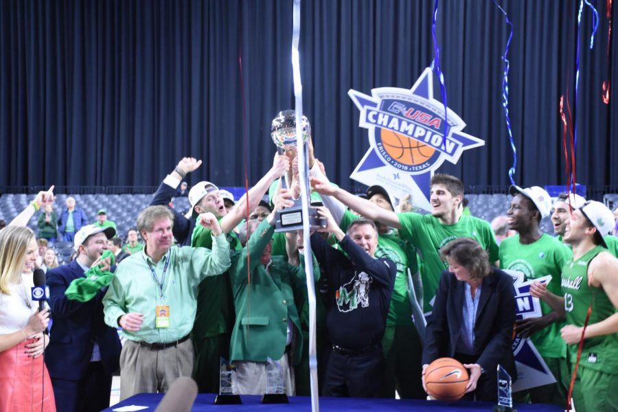 %28L-R%29+Marshall+athletic+director+Mike+Hamrick%2C+president+Jerome+Gilbert+and+head+coach+Dan+D%E2%80%99Antoni+lift+the+Conference+USA+championship+trophy.
