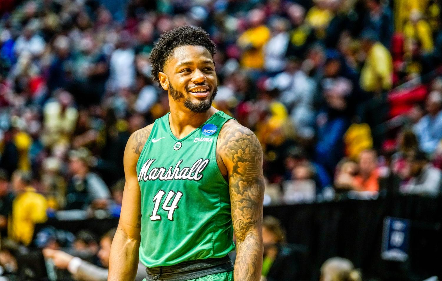 Junior+guard+C.J.+Burks+smiles+in-game+as+Marshall+approaches+its+first-ever+NCAA+Tournament+win.