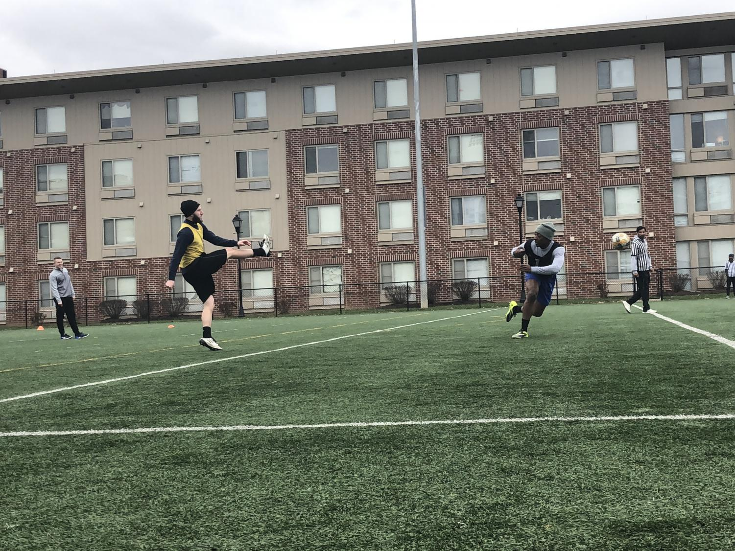 Members of the Alpha Tau Omega and Marshall Recreation Center staff members playing soccer on the Marshall Rec fields outside of freshman south dorms.