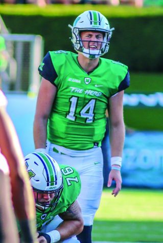 Quarterback Chase Litton (14) calls out a play during the Herd's game against ODU October 14, 2017. Litton, who declared for the NFL Draft, took part in the NFL Scouting Combine last week and Marshall's pro day Wednesday.