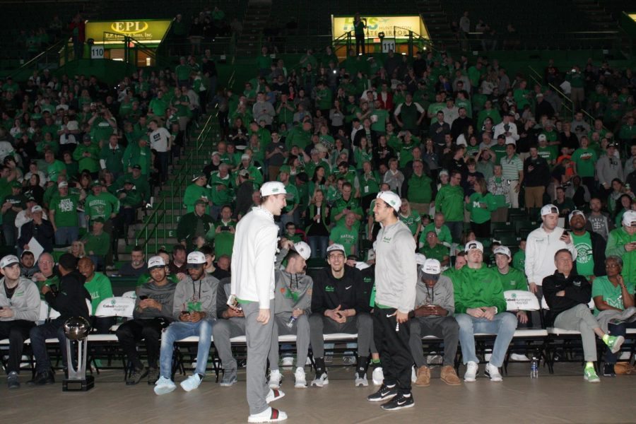 Junior+guard+Jon+Elmore+and+freshman+guard+Jarrod+West+celebrate+during+Marshall%27s+Selection+Sunday+viewing+party.