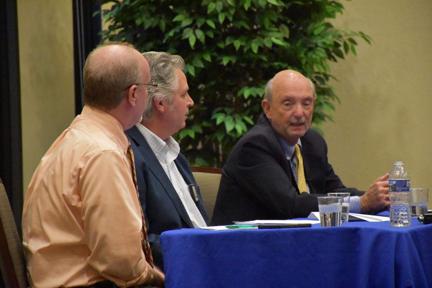 Marshall Journalism Professor Dan Hollis (Left) Eric Eyre (Middle) and John Hackworth (Right),  Eyre and Hackworth Pulitzer Prize winners, spoke to Huntington community members about being an informed citizen and the path to the Pulitzer Prize Monday, at the Brad D. Smith Foundation Hall.