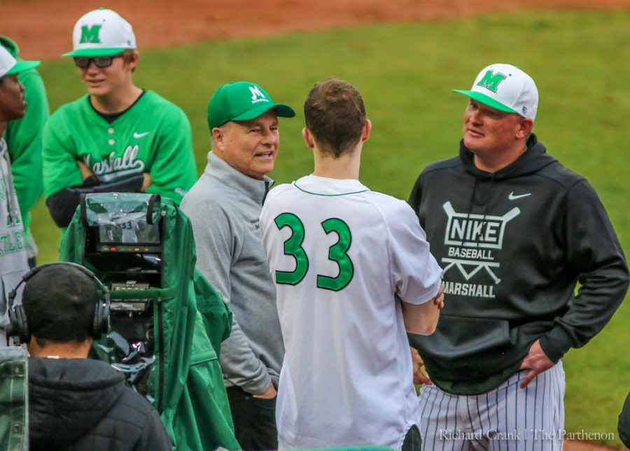 Marshall+basketball+head+coach+Dan+D%27Antoni+and+junior+guard+Jon+Elmore+converse+with+head+baseball+coach+Jeff+Waggoner+before+throwing+out+the+ceremonial+first+pitch.+
